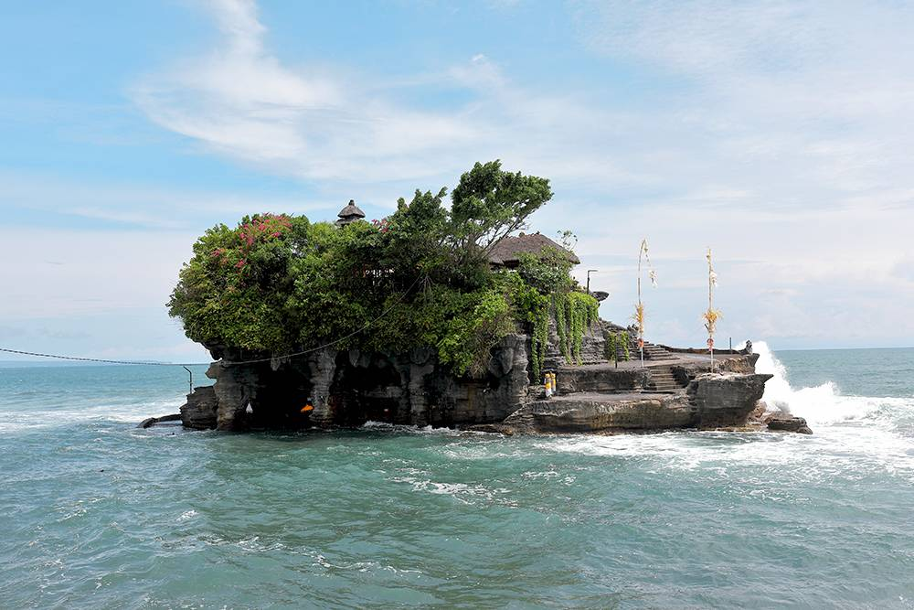 The Tanah Lot temple can get a little crowded, but this beauty is an easy trip from Canggu and is one of Bali's most famous sights for good reason